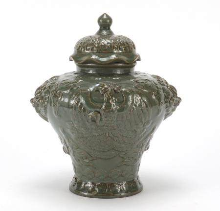 Chinese pottery green glazed jar and cover, relief decorated with a phoenix and lion mask handles,