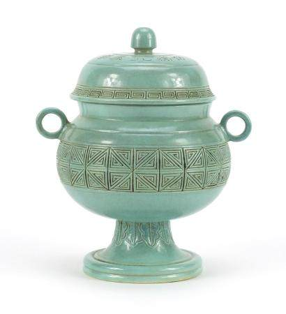 Chinese porcelain pedestal jar and cover with twin handles, character marks to the base, 18cm high :