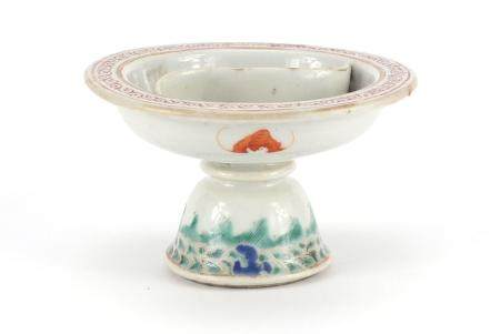 Chinese porcelain pedestal sectional dish, hand painted in the famille rose palette with flowers and