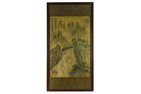 A large Chinese scroll painting depicting a mountain landscape, framed