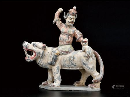 陶彩绘胡人骑虎塑像