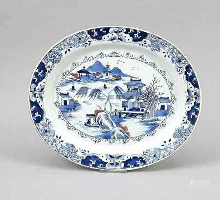 Oval bowl, China, 20th cent. Cobalt-blue and copper-red decoration in the style of 18th