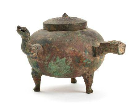 A BRONZE HANDLED AND SPOUTED GLOBULAR EWER,