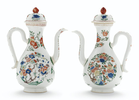 A PAIR OF FAMILLE VERTE EWERS AND COVERS