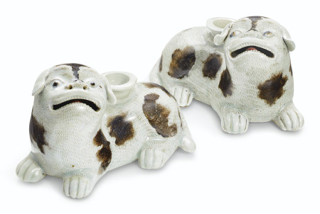 A PAIR OF SPOTTED PUG CANDLEHOLDERS
