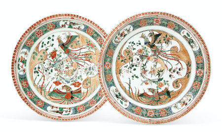 A LARGE PAIR OF FAMILLE VERTE PIE-CRUST RIM CHARGERS