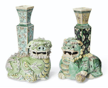 TWO BISCUIT-GLAZED BUDDHIST LION VASES