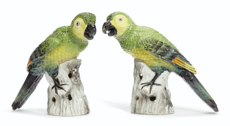 A PAIR OF GREEN MACAWS