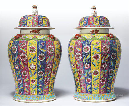 A LARGE PAIR OF FAMILLE ROSE JARS AND COVERS