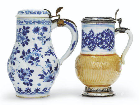 TWO BLUE AND WHITE TANKARDS