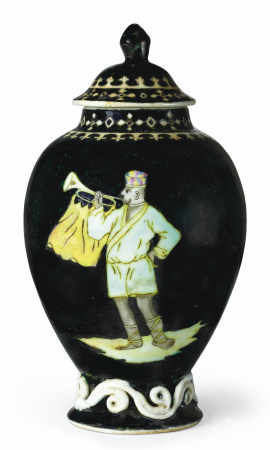 A RARE BLACK-GROUND 'TRUMPETER' TEA CADDY AND COVER