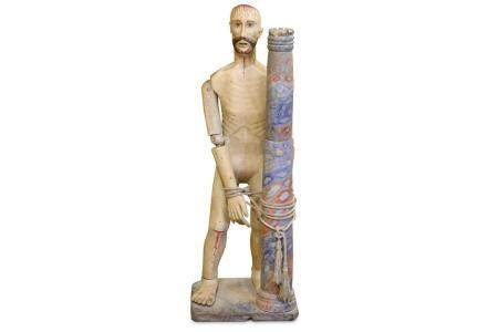 A 19TH CENTURY CARVED WOOD AND POLYCHROME DECORATED FIGURE O