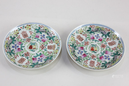 A pair of Chinese famille rose porcelain saucers, decorated with character symbols, butterflies, and