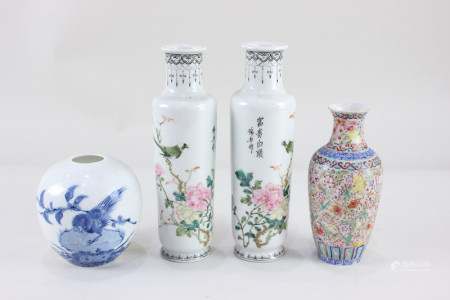 A pair of small Chinese porcelain vases, of cylindrical form, decorated with birds on flowering