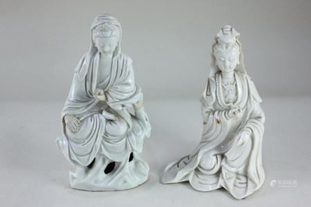 Two Eastern white glazed porcelain figures, possibly Korean, both seated, one on pierced base,