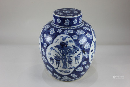 A Chinese blue and white porcelain ginger jar decorated with panels of garden scenes, on blue prunus