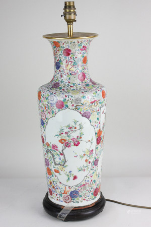 A Chinese porcelain baluster vase converted to a table lamp, with polychrome decoration of flowers