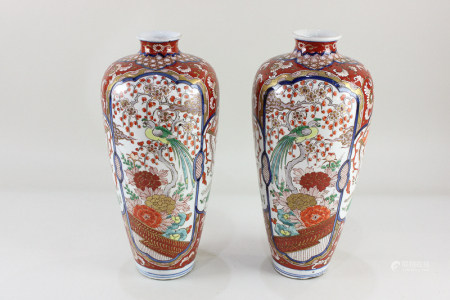 A pair of Japanese porcelain vases, of slender baluster form, decorated in the Imari palette with