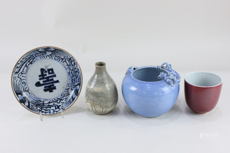 A Chinese porcelain blue glazed porcelain vase, of concave bowl shaped form, decorated with a