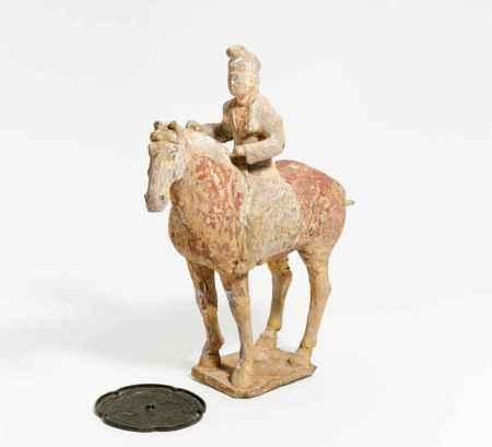 HORSEMAN IN WESTERN ASIAN GARMENT.