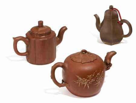 THREE ZISHA TEA POTS.