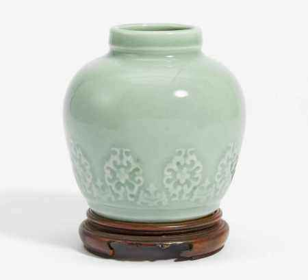 SMALL VASE WITH MODELED LOTUS BLOSSOMS IN FLAT RELIEF.