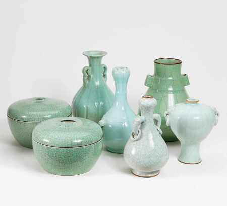FIVE VASES AND A PAIR OF LIDDED BOXES.