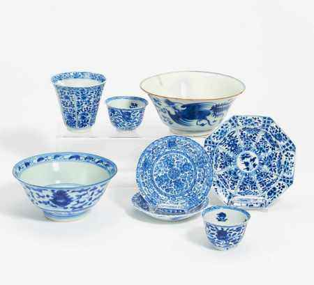 THREE CUPS WITH SAUCERS AND TWO BOWLS BLUE AND WHITE PORCELAIN.