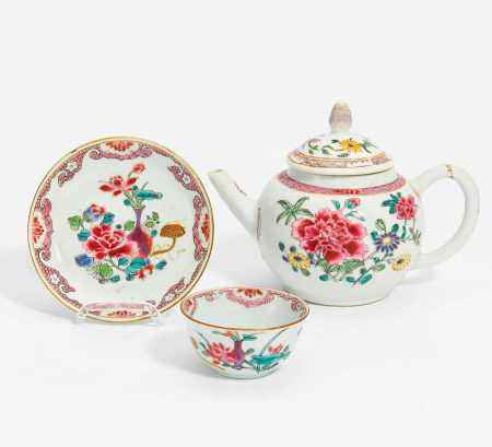 TEA POT, CUP AND SAUCER WITH FLOWER DECORATION.