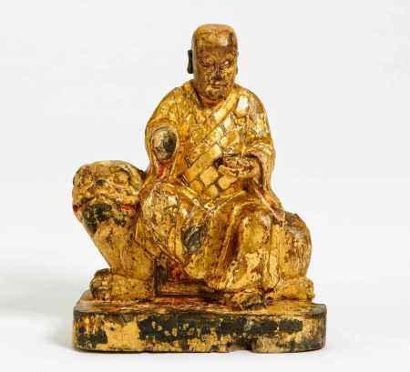 KSITIGARBHA AS MONK SITTING ON LION.
