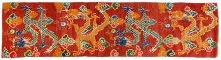 LONG CARPET WITH FOUR DRAGONS CHASING THE FLAMING PEARL.