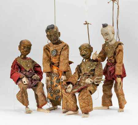FOUR LARGE PUPPETS.
