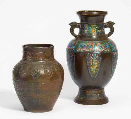 TWO VASES WITH ARCHAISING DRAGON DECOR.
