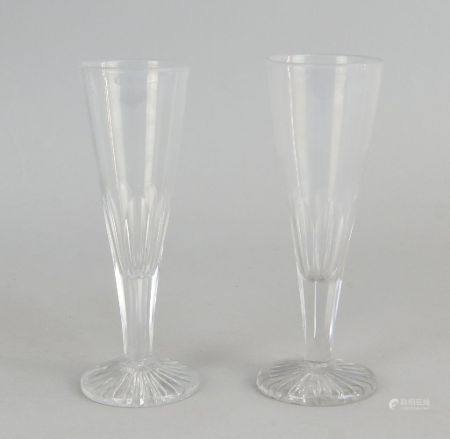 Two drinking glasses, 19th century, of tapering conical form with facetted stems on circular