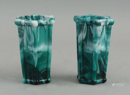 A pair of Victorian green and white opaline glass vases, of hexagonal form, with ribbed edges,