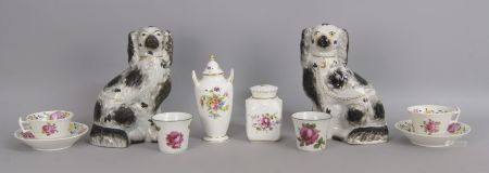 A pair of Staffordshire pottery spaniels, 19th century, decorated with black splash designs, 26cm