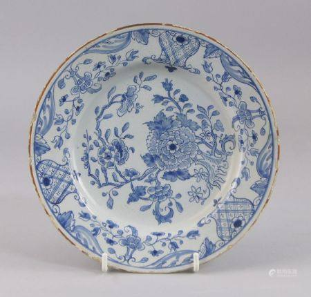 A Continental tin glazed earthenware plate, 19th century, decorated with Chinese flowers to the