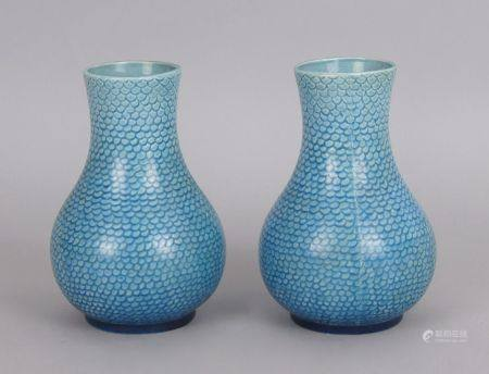 A pair of Continental blue majolica vases, late 19th century, overall decorated with scale