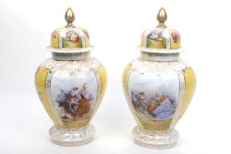 A pair of Vienna style porcelain jars and covers, late 19th/early 20th century, printed with