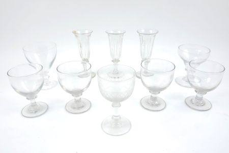 A collection of four late Georgian glass rummers, with rounded bowls, on cylindrical stems, with