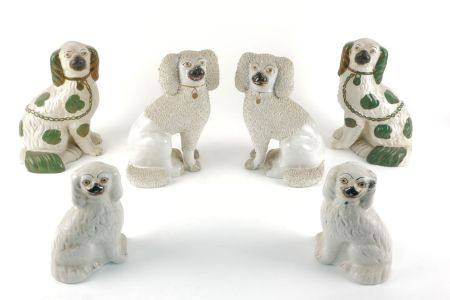 A pair of Staffordshire white pottery dogs, 19th century, with textured ears, bodies and tails, with