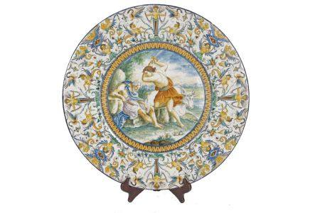 An Italian tin glazed earthenware maiolica charger, late 19th/20th century, decorated to the