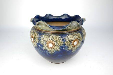 A Royal Doulton jardinière, with a wavy edge and a cord form band hung with moulded leaves and