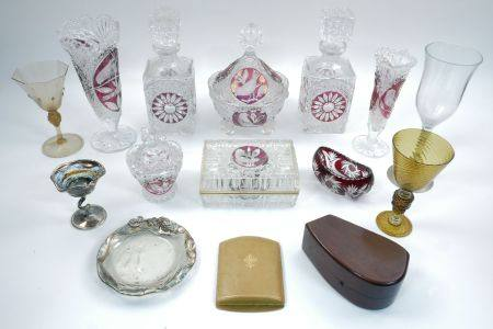 A pair of modern square glass and ruby glass decanters, with square glass stoppers, moulded with