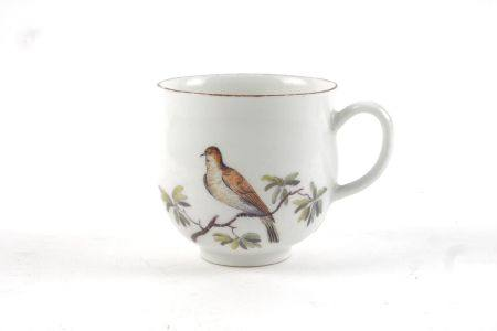 A Chelsea style tea cup, probably Samson, 19th century, decorated to the rim with a brown line, with