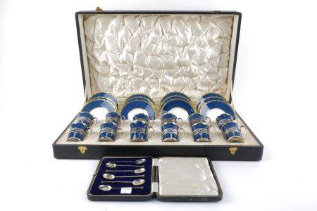 An boxed set of twelve Aynsley bone china coffee cans and saucers, with pierced silver mounted