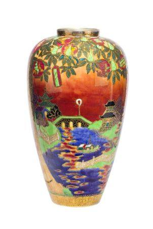 Daisy Makeig-Jones, British, 1881-1941, a Wedgwood Fairyland Lustre 'Willow and Candle lighthouse'