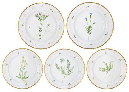 A pair of large Royal Copenhagen Flora Danica porcelain plates, 20th century, with serrated gilt