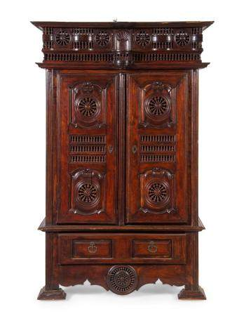 A Brittany Style Carved Walnut Armoire