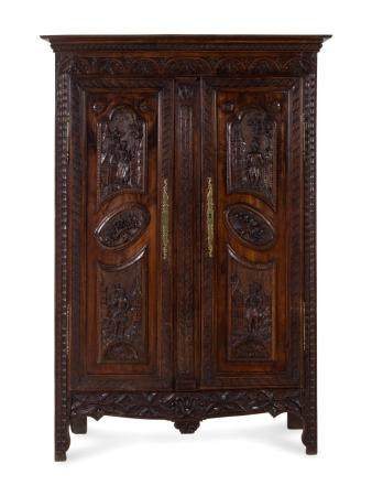 A Brittany Style Carved Oak Armoire